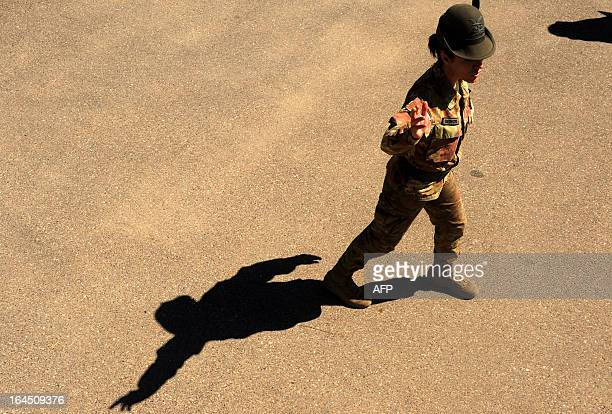 An Italian soldier walks during a change of command between Italian forces at a military camp near Herat airport on March 24 2012 Italy has 3800...