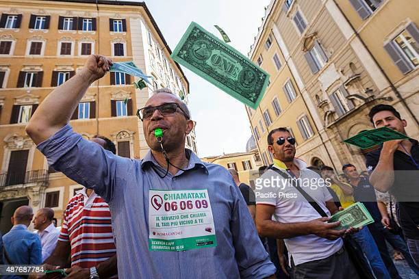An Italian taxi driver blows a whistle as he take part in a demonstration to protest against Uber service in Rome Hundreds of Italian taxi drivers...