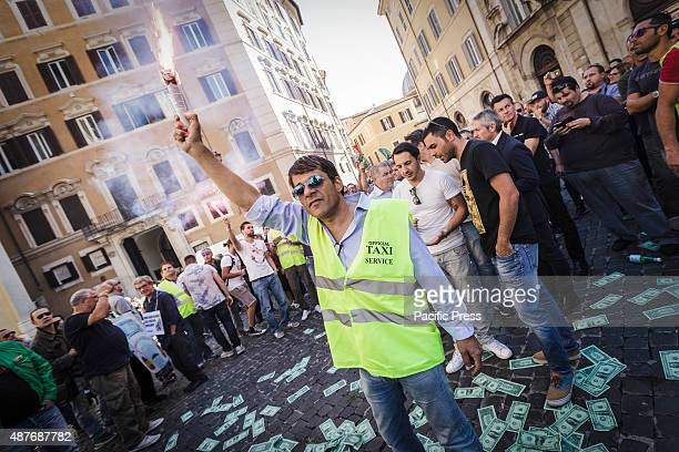 An Italian taxi driver lights a flare as he take part in a demonstration to protest against Uber service in Rome Hundreds of Italian taxi drivers...