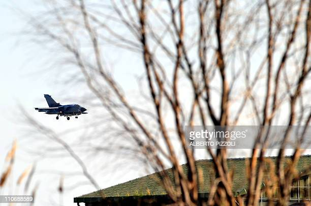 An Italian Tornado jet prepares to land on March 23 2011 at TrapaniBirgi airbase in Sicily NATO debated the same day whether the alliance should join...