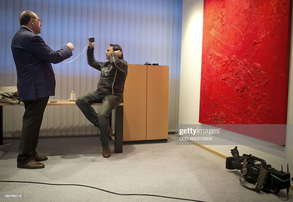 An Italian TV crew uses an iphone to go live from a press conference with the leader of the Italian center left Democratic Party Pier Luigi Bersani at the German Social Democratic Party headquarters, Willy Brandt house, in Berlin on February 5, 2013.