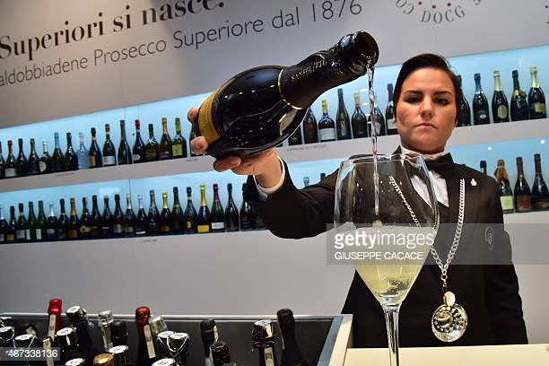 An Italian vendor serves Prosecco Valdobbiane superior on March 23 2015 at the Vinitaly exposition in Verona AFP PHOTO / GIUSEPPE CACACE