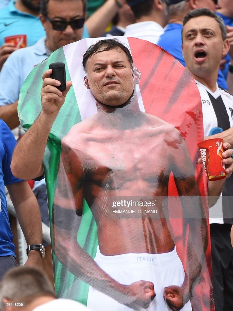 An Italy fan poses as Italy's forward Mario Balotelli prior to the Group D football match between Italy and Uruguay at the Dunas Arena in Natal during the 2014 FIFA World Cup on June 24, 2014.