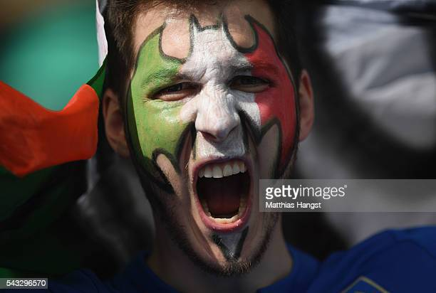 An Italy supporter enjoys the atmosphere prior to the UEFA EURO 2016 round of 16 match between Italy and Spain at Stade de France on June 27 2016 in...