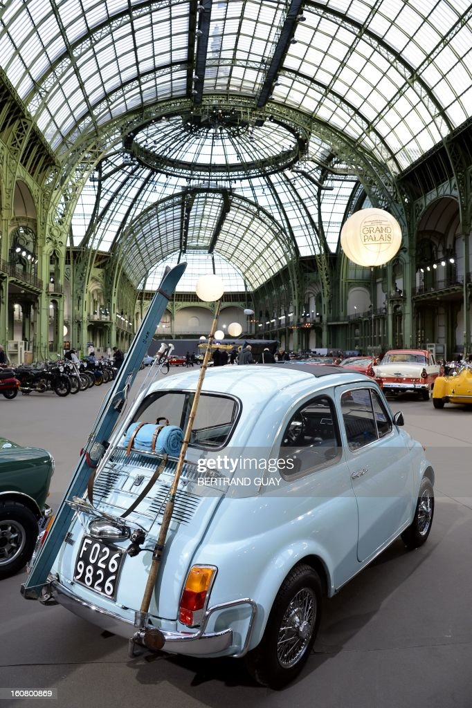 An Italy's Fiat 500L (1972) is pictured as luxury vintages cars are displayed at an auction at the Grand Palais on February 6, 2013 in Paris. 125 vintage motor cars, 100 collection motorbikes and a 1920's Gipsy Moth plane by De Havilland, will be presented at the Bonhams auction on February 7.