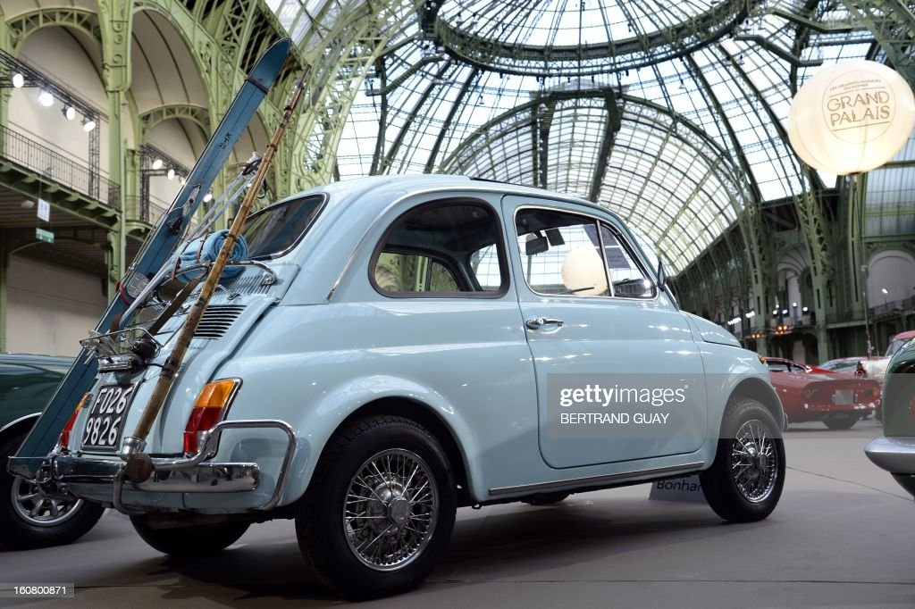 An Italy's Fiat 500L (1972) is pictured as luxury vintages cars are displayed at an auction at the Grand Palais on February 6, 2013 in Paris. 125 vintage motor cars, 100 collection motorbikes and a 1920's Gipsy Moth plane by De Havilland, will be presented at the Bonhams auction on February 7. AFP PHOTO BERTRAND GUAY