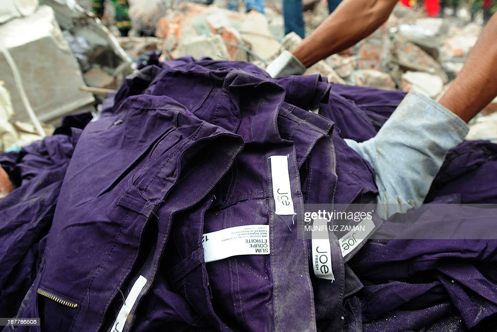 An item of clothing with a Joe Fresh label lies in the rubble after an eight-storey building collapsed in Savar, on the outskirts of Dhaka, on April 30, 2013. Bangladesh on Tuesday defended its decision to snub foreign aid after the collapse of a factory complex as anger flared at the recovery operation and towards the building's owner when he appeared in court, with the death toll from the country's worst ever industrial disaster now standing at 387.