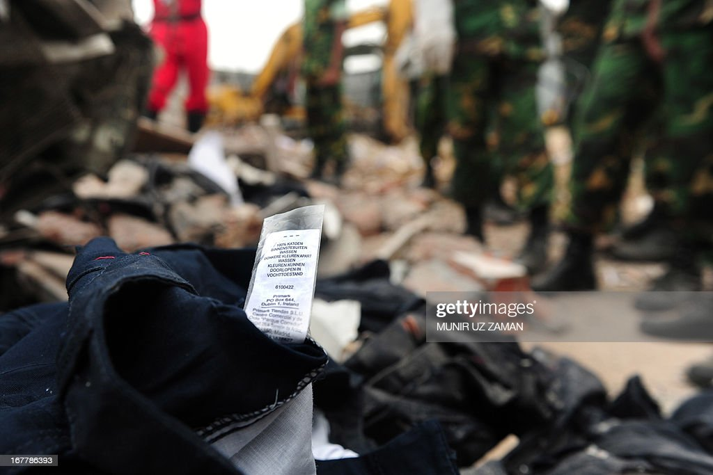 An item of clothing with a Primark label lies in the rubble after an eight-storey building collapsed in Savar, on the outskirts of Dhaka, on April 30, 2013. Bangladesh on Tuesday defended its decision to snub foreign aid after the collapse of a factory complex as anger flared at the recovery operation and towards the building's owner when he appeared in court, with the death toll from the country's worst ever industrial disaster now standing at 387.