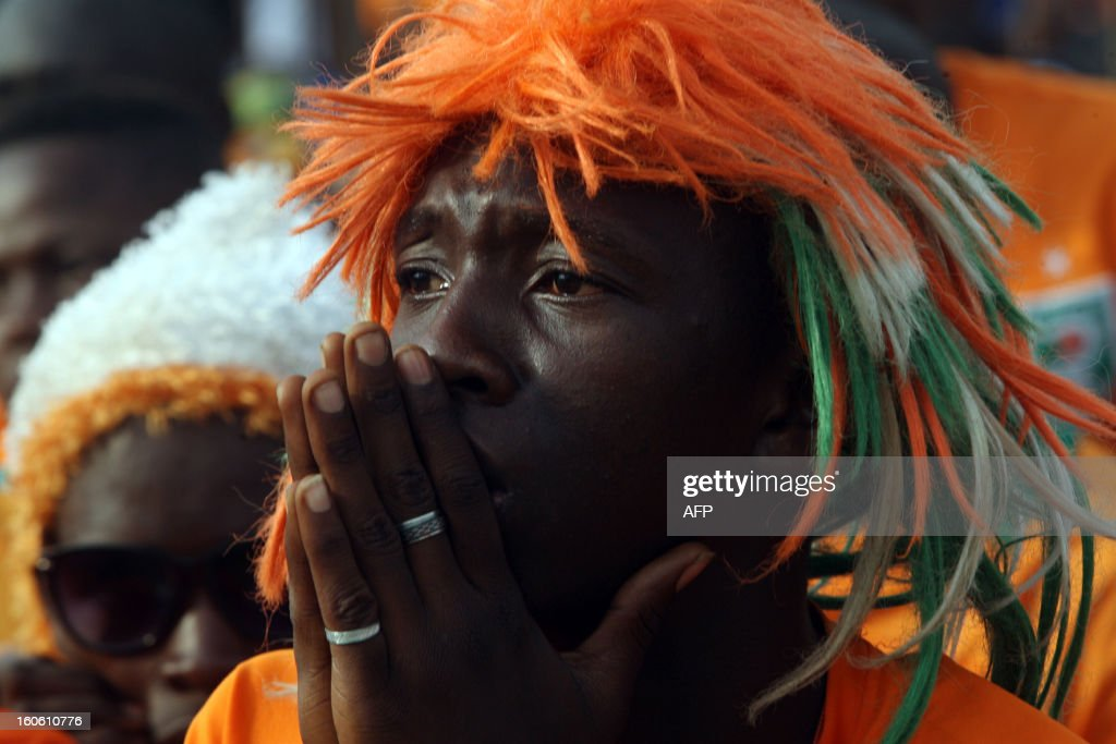 An Ivorian supporter reacts, on February 3, 2013 in the Yopougon district in Abidjan, as he watches on a big screen the African Cup of Nation 2013 quarter final football match Ivory Coast vs Nigeria, in Rustenburg. Supposed underdogs Nigeria downed favourites Ivory Coast 2-1 in Rustenburg today, in an absorbing Africa Cup of Nations quarter-final to set up a last-four meeting with Mali.