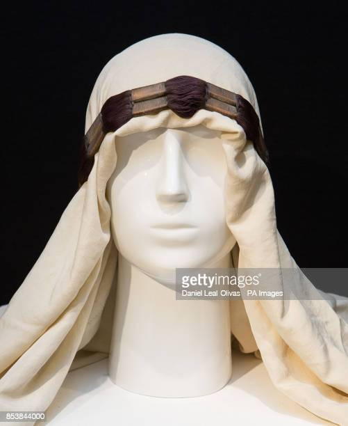 An ivory silk headdress owned by T E Lawrence which is part of the Famous and Infamous exhibition which includes highlights from the collection of...