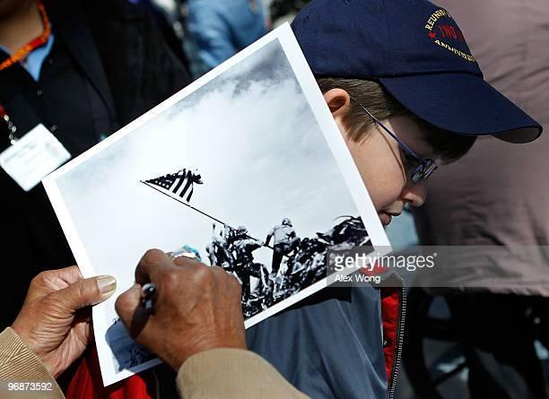 An Iwo Jima veteran signs autograph on the famous WWII photograph Raising the Flag on Iwo Jima shot by AP photographer Joe Rosenthal for Michael...