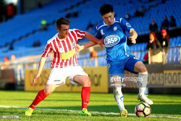 An Jinya of Olympic FC and Marcus Donatiello of Parramatta FC challenge for the ball during the NSW NPL Men's match between Sydney Olympic FC and...