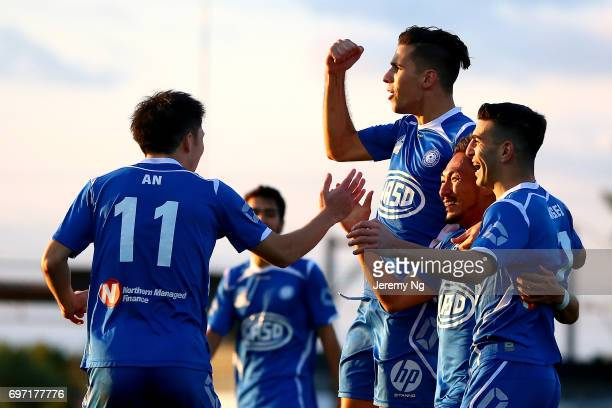 An Jinya William Angel and Radovan Pavicevic of Olympic FC celebrate a goal scored by Yu Kuboki during the NSW NPL Men's match between Sydney Olympic...