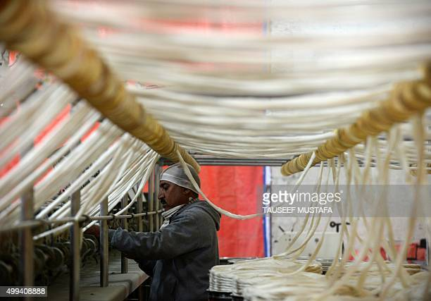 An Kashmir artisan works at a silk factory on the outskirts of Srinagar on December 1 2015 The Silk industry was one of the best revenue earning...
