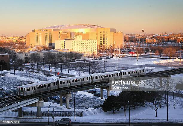 An L train navigates a frozen landscape near the United Center with temperatures hovering around 10 degrees January 28 2014 in Chicago Illinois The...
