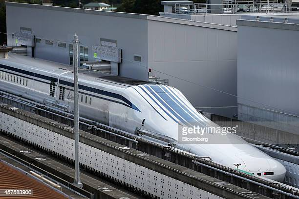 An L0 series magnetic levitation train developed by Central Japan Railway Co sits on tracks at the Yamanashi Maglev Test Track site in Tsuru...