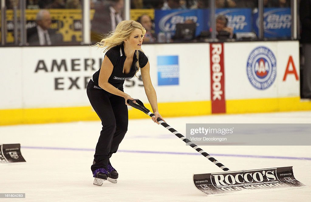 An L.A. Kings ice girl shovels snow off the ice during a break in the NHL game between the Columbus Blue Jackets and the Los Angeles Kings at Staples Center on February 15, 2013 in Los Angeles, California. The Kings defeated the Blue Jackets 2-1.