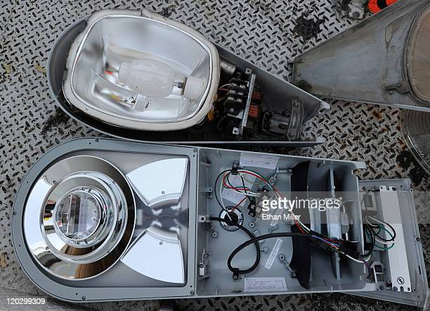 An LED fixture is displayed next to an older streetlight August 3 2011 in Las Vegas Nevada The city is replacing 6600 existing streetlights with the...