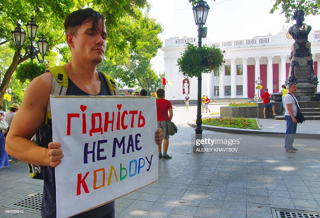 An Lesbian gay bisexual and transgender activists holds placard reading 'Dignity has no color'during his single picket at the city hall of southern...