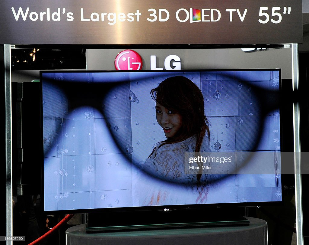 An LG 55-inch 3-D OLED TV is is partially seen through a pair of 3-D glasses at the LG Electronics booth at the 2012 International Consumer Electronics Show at the Las Vegas Convention Center January 11, 2012 in Las Vegas, Nevada. CES, the world's largest annual consumer technology trade show, runs through January 13 and features more than 3,100 exhibitors showing off their latest products and services to about 140,000 attendees.
