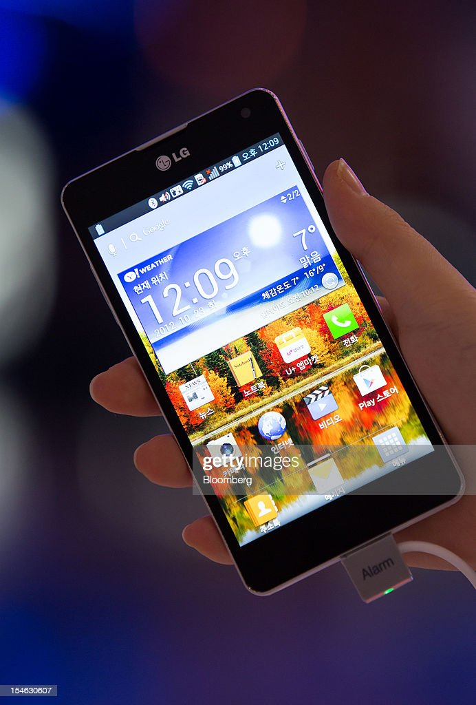 An LG Electronics Inc. Optimus G smartphone is arranged for a photograph at the company's showroom in the COEX mall in Seoul, South Korea, on Tuesday, Oct. 23, 2012. LG is scheduled to release third-quarter earnings today. Photographer: SeongJoon Cho/Bloomberg via Getty Images