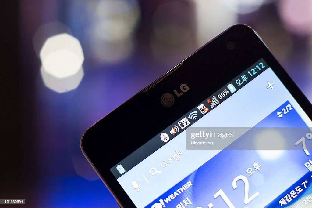 An LG Electronics Inc. Optimus G smartphone is displayed for a photograph at the company's showroom in the COEX mall in Seoul, South Korea, on Tuesday, Oct. 23, 2012. LG is scheduled to release third-quarter earnings today. Photographer: SeongJoon Cho/Bloomberg via Getty Images