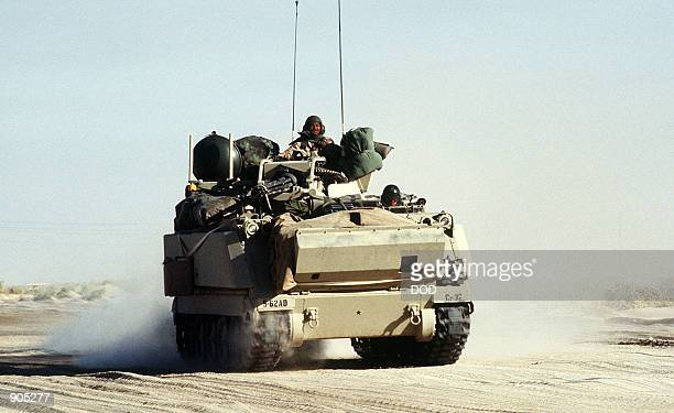 An M163 Vulcan 20mm selfpropelled antiaircraft gun system travels with a convoy on a desert road during Operation Desert Shield