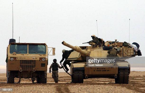 An M1/A1 Abrams tank from the charlie company 464 Armored Battalion stops at a refuel point during task force manuevers December 17 2002 near the...