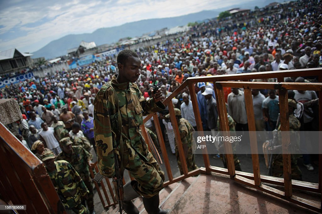 An M23 rebel soldier climbs some steps in the Volcanoes Stadium in Goma on November 21, 2012. The spokesman of the M23 rebel group Vianney Kazarama addressed the population of Goma today in an attempt to calm and reassure the civilians following the fall of Goma to M23 rebels yesterday.