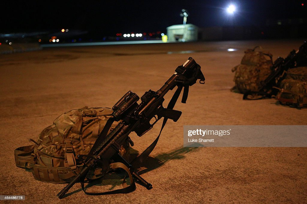 An M4 carbine belonging to a member of the US Army's 159th Combat Aviation Brigade 101st Airborne Division sits on the tarmac during a homecoming...