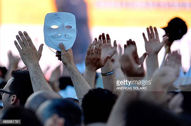 An M5S supporter holds an Anonymous Guy Fawkes mask during an antiestablishment 5Star Movement rally on May 23 in Rome's Piazza San Giovanni in...