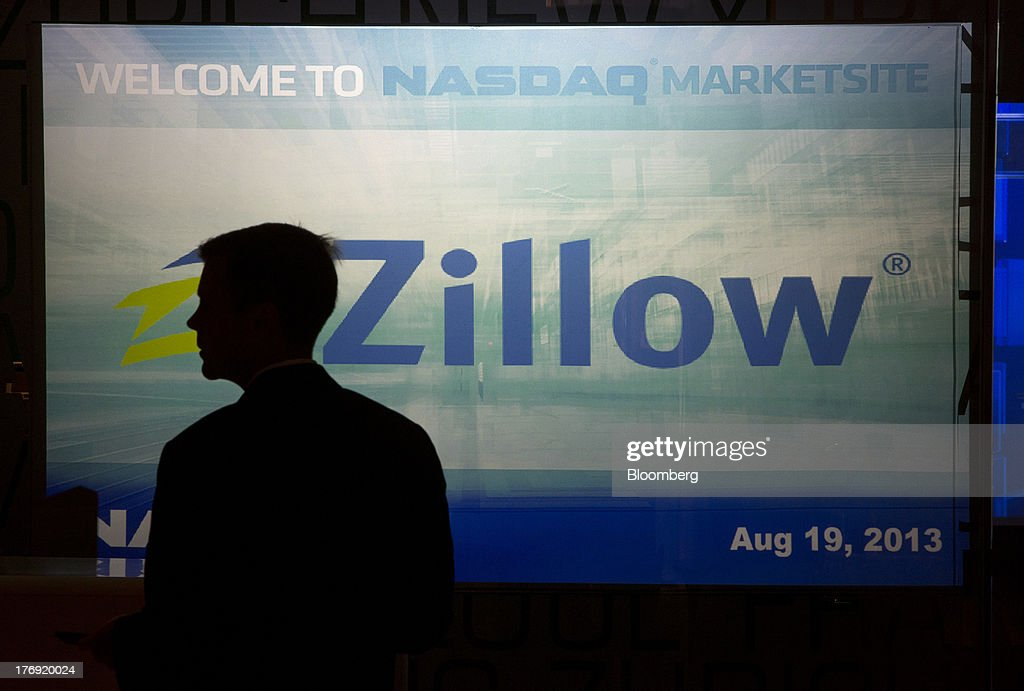 An man passes Zillow Inc. signage at the Nasdaq MarketSite in New York, U.S., on Monday, Aug. 19, 2013. Zillow Inc., operator of the largest U.S. real-estate website, agreed to acquire StreetEasy for $50 million in cash to expand its coverage of the New York market. Photographer: Scott Eells/Bloomberg via Getty Images