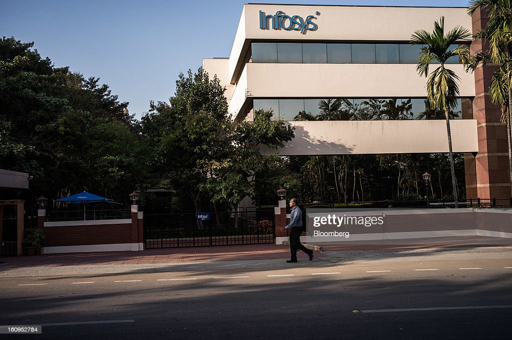 An man walks past the Infosys Ltd. campus in Electronics City in Bangalore, India, on Monday, Feb. 4, 2013. Infosys is India's No. 2 software exporter. Photographer: Sanjit Das/Bloomberg via Getty Images