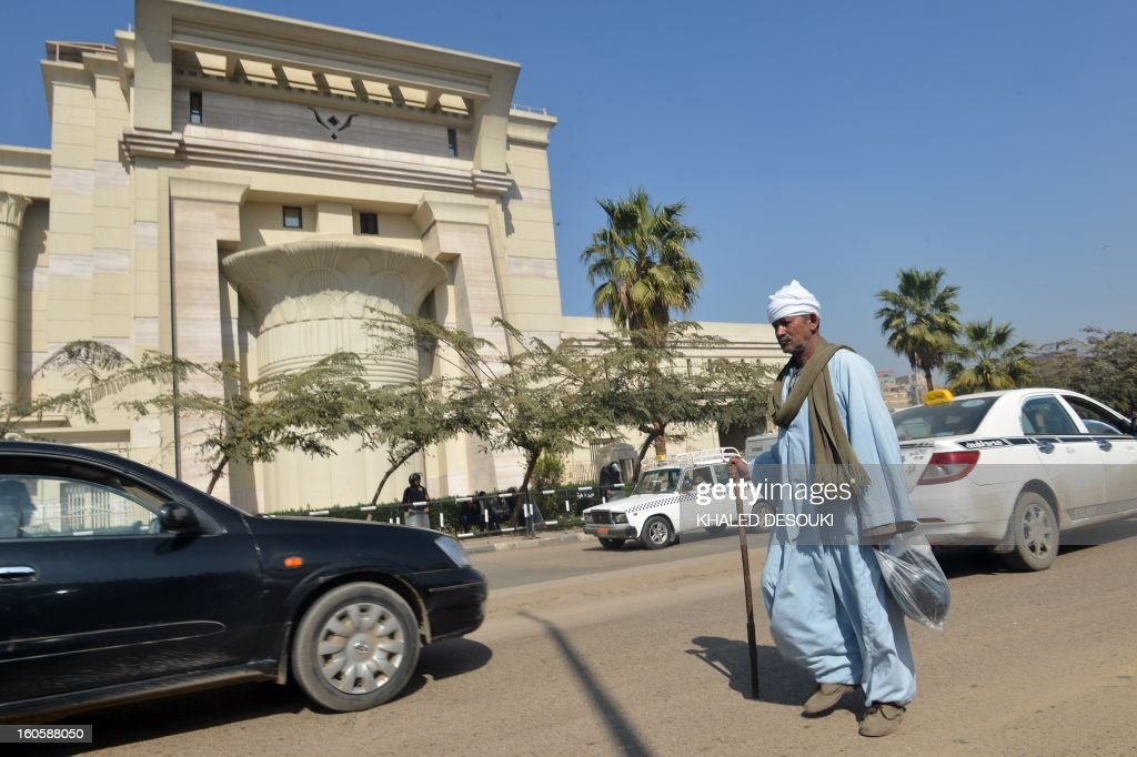 An man walks past the Supreme Constitutional Court in Cairo, on February 3, 2013 as Egypt's top court postponed until March 3, a ruling on the legality of the Islamist-dominated commission that drafted a contested new constitution, state media reported. AFP PHOTO / KHALED DESOUKI