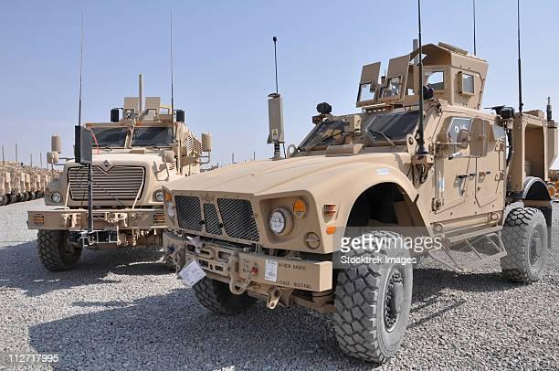 An M-ATV Mine Resistant Ambush Protected vehicle parked next to a MaxxPro MRAP.