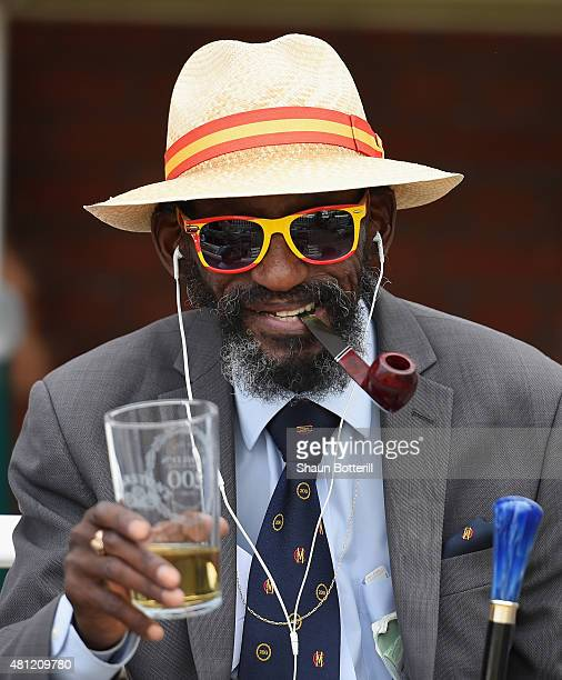 An MCC member enjoys a pint during day three of the 2nd Investec Ashes Test match between England and Australia at Lord's Cricket Ground on July 18...