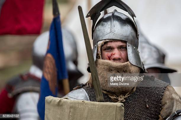 An medieval enthusiast takes part in the reenactment of a medieval battle in the Czech Republic on April 23 2016 in Libusin Czech Republic About 2000...