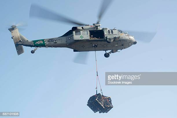 An MH-60S Knighthawk delivers cargo.