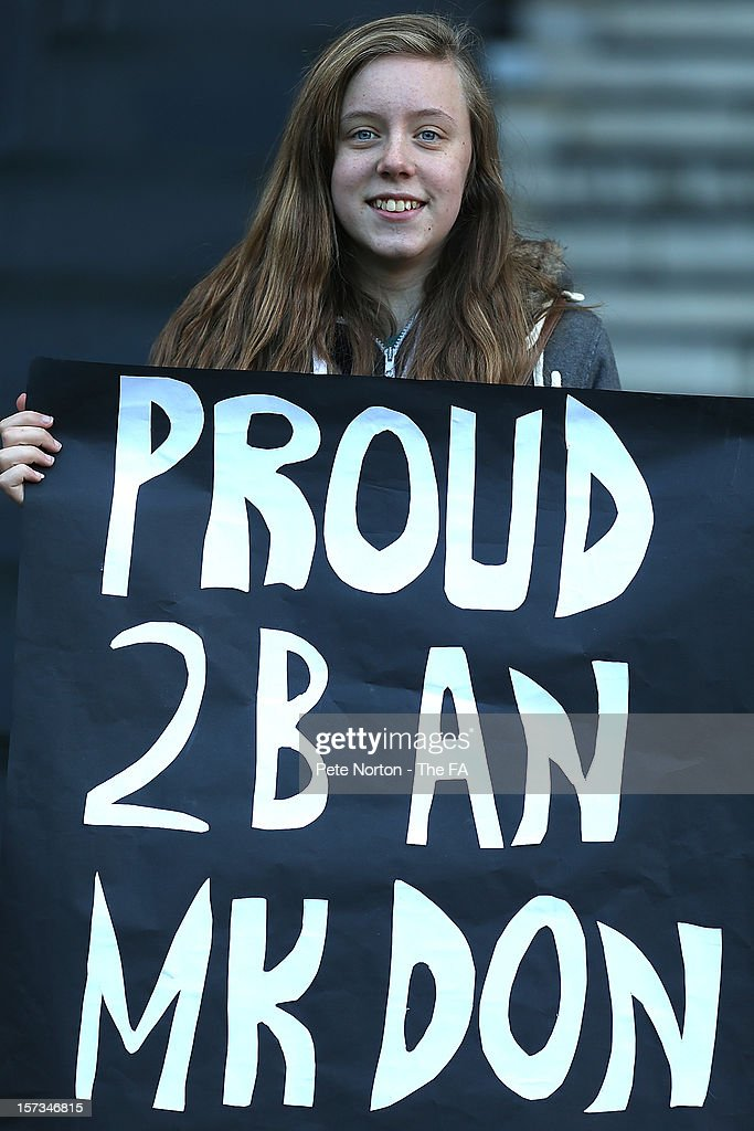 An MK Dons fan shows her support during the FA Cup with Budweiser Second Round match between MK Dons and AFC Wimbledon at StadiumMK on December 2, 2012 in Milton Keynes, England.
