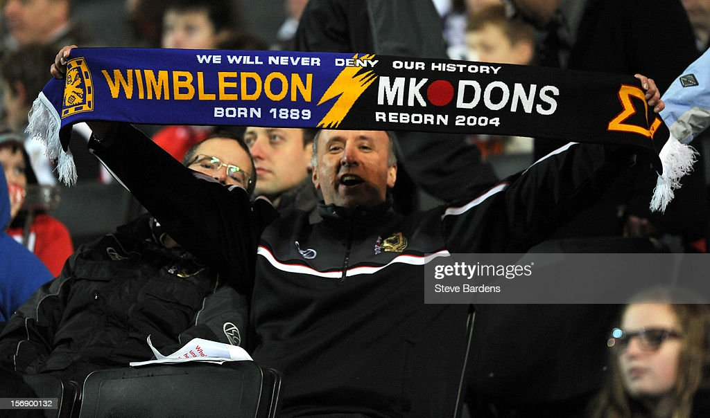 An MK Dons fan with a Wimbledon and MK Dons scarf during the npower League One match between MK Dons and Colchester United at Stadium MK on November 24, 2012 in Milton Keynes, England.