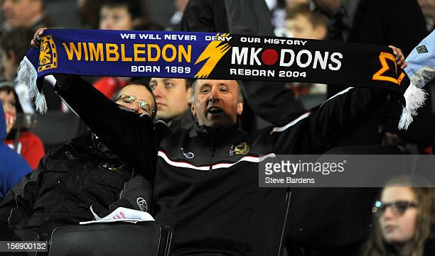 An MK Dons fan with a Wimbledon and MK Dons scarf during the npower League One match between MK Dons and Colchester United at Stadium MK on November...