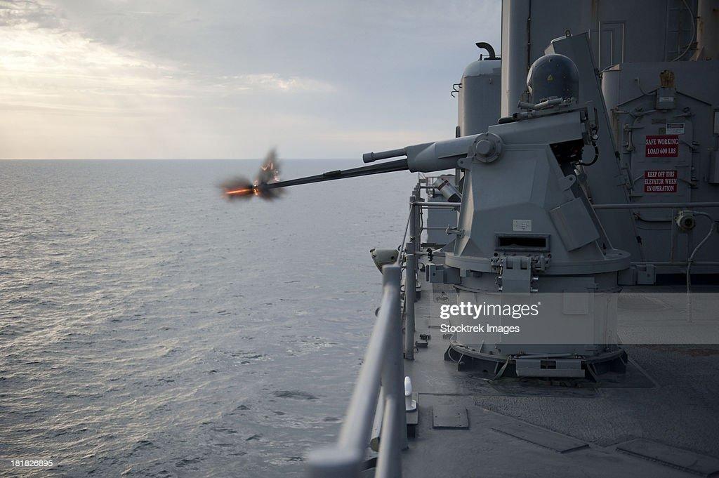 An MK38 MOD 2 25mm machine gun system aboard USS Pearl Harbor.