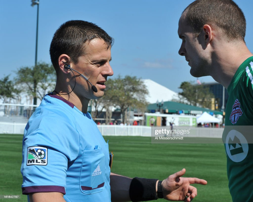 An MLS officials talks to goalie <a gi-track='captionPersonalityLinkClicked' href=/galleries/search?phrase=Stefan+Frei&family=editorial&specificpeople=5719349 ng-click='$event.stopPropagation()'>Stefan Frei</a> #24 of Toronto FC before play against the Columbus Crew February 9, 2013 in the first round of the Disney Pro Soccer Classic in Orlando, Florida. Columbus won 1 - 0.