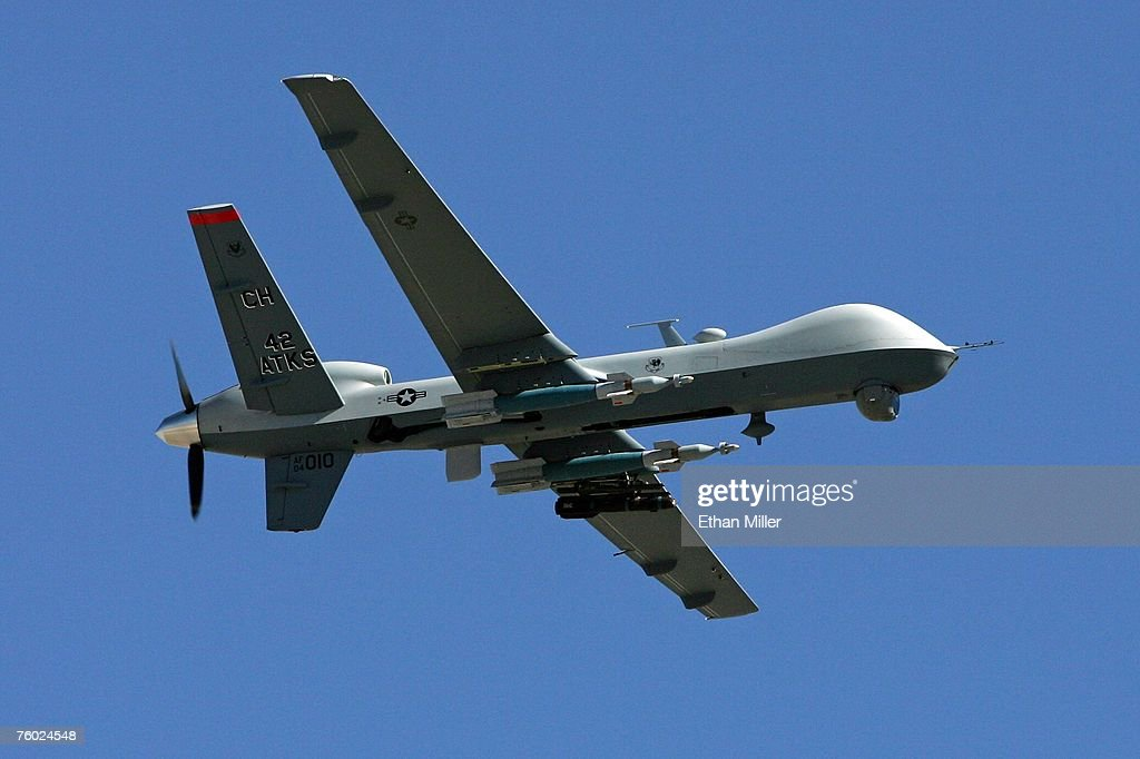 An MQ-9 Reaper flies by August 8, 2007 at Creech Air Force Base in Indian Springs, Nevada. The Reaper is the Air Force's first 'hunter-killer' unmanned aerial vehicle (UAV), designed to engage time-sensitive targets on the battlefield as well as provide intelligence and surveillance. The jet-fighter sized Reapers are 36 feet long with 66-foot wingspans and can fly for up to 14 hours fully loaded with laser-guided bombs and air-to-ground missiles. They can fly twice as fast and high as the smaller MQ-1 Predators, reaching speeds of 300 mph at an altitude of up to 50,000 feet. The aircraft are flown by a pilot and a sensor operator from ground control stations. The Reapers are expected to be used in combat operations by the U.S. military in Afghanistan and Iraq within the next year.