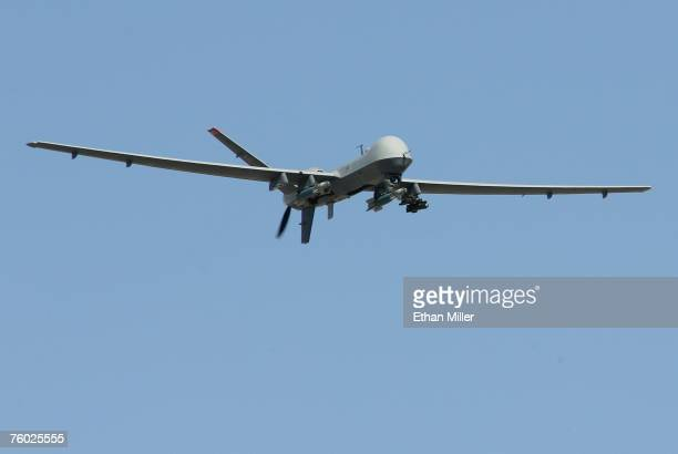 An MQ9 Reaper flies by on a training mission August 8 2007 at Creech Air Force Base in Indian Springs Nevada The Reaper is the Air Force's first...