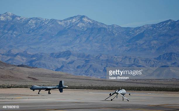 An MQ9 Reaper remotely piloted aircraft and an MQ1B Predator RPA taxi during a training mission at Creech Air Force Base on November 17 2015 in...
