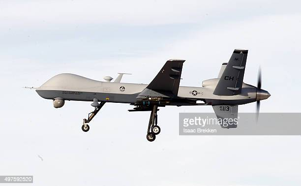 An MQ9 Reaper remotely piloted aircraft flies by during a training mission at Creech Air Force Base on November 17 2015 in Indian Springs Nevada The...
