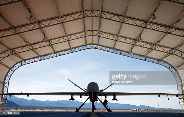 An MQ9 Reaper remotely piloted aircraft is parked in an aircraft shelter at Creech Air Force Base on November 17 2015 in Indian Springs Nevada The...