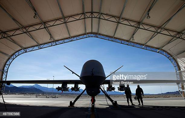 An MQ9 Reaper remotely piloted aircraft is prepared for a training mission at Creech Air Force Base on November 17 2015 in Indian Springs Nevada The...