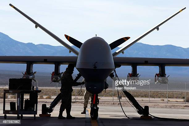 An MQ9 Reaper remotely piloted aircraft is prepared for training mission at Creech Air Force Base on November 17 2015 in Indian Springs Nevada The...